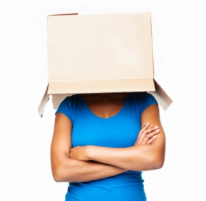 Woman With Brown Box On Her Head - Isolated