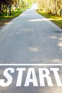 asphalt road with white start sign