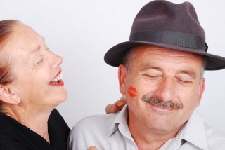 Senior couple kiss situation in white isolated background