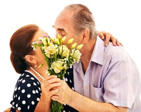 25499221 - old man embracing woman sharpness on the bouquet